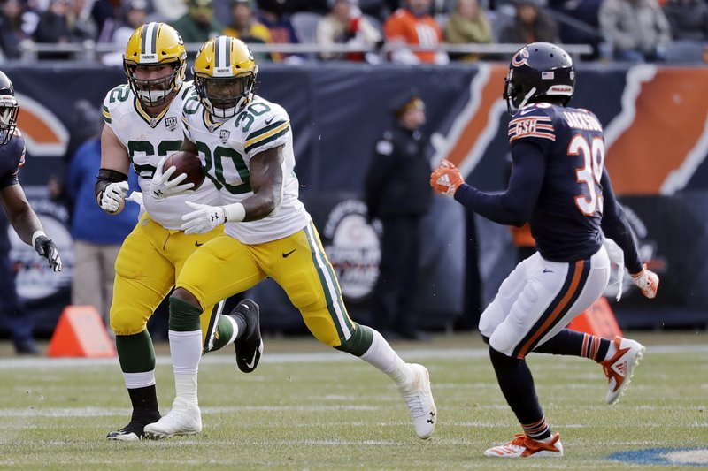 Green Bay Packers running back Jamaal Williams (30) runs against Chicago Bears defensive back Eddie Jackson (39) during the first half of an NFL football game against the Chicago Bears Sunday, Dec. (AP Photo/Nam Y. Huh)
