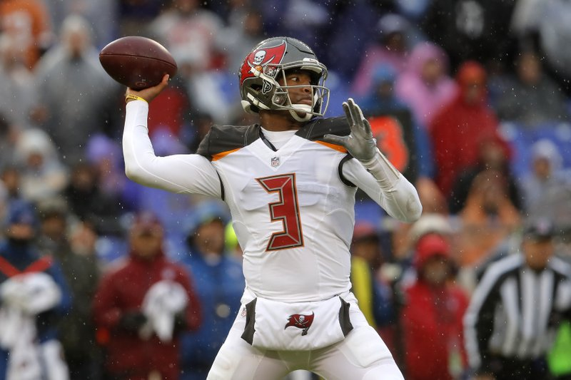 Tampa Bay Buccaneers quarterback Jameis Winston throws a pass in the first half of an NFL football game against the Baltimore Ravens, Sunday, Dec. (AP Photo/Carolyn Kaster)