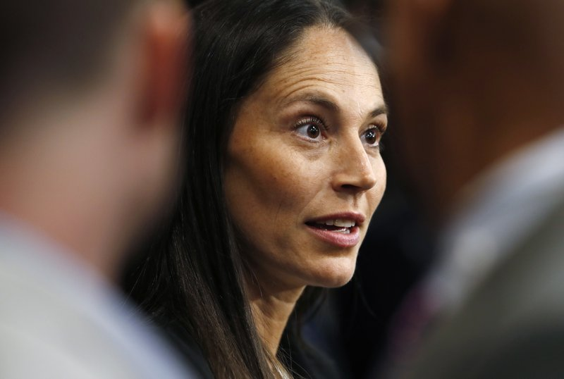 Sue Bird talks about being hired as a basketball operations associate by the Denver Nuggets before an NBA basketball game Sunday, Dec. (AP Photo/David Zalubowski)