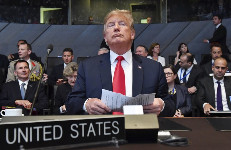 FILE - In this Wednesday, July 11, 2018 file photo U.S. President Donald Trump attends a meeting of the North Atlantic Council during a summit of heads of state and government at NATO headquarters in Brussels. (AP Photo/Geert Vanden Wijngaert, File)