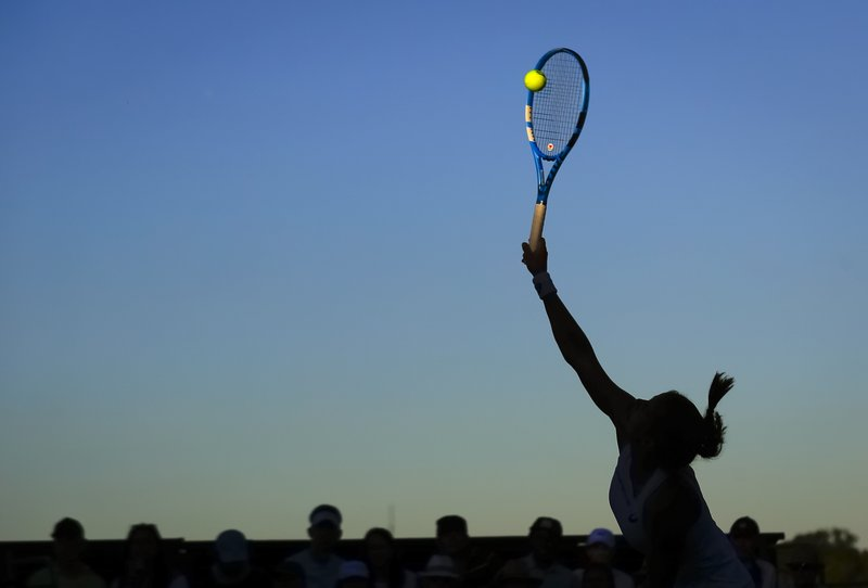 FILE - In this Monday July 2, 2018 file photo Julia Goerges of Germany serves to Monica Puig of Puerto Rica during the Women's Singles first round match at the Wimbledon Tennis Championships in London. (AP Photo/Ben Curtis, File)