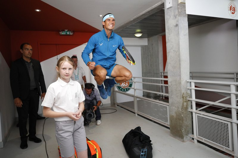 FILE - In this Sunday, June 10, 2018 file photo Spain's Rafael Nadal jumps in a corridor before his men's final match of the French Open tennis tournament against Austria's Dominic Thiem at the Roland Garros stadium in Paris. (AP Photo/Christophe Ena, File)
