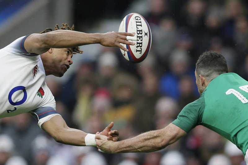 FILE - In this Saturday, March 17, 2018 file photo England's Anthony Watson, left, and Ireland's Rob Kearney try to catch the ball during the Six Nations rugby union match between England and Ireland at Twickenham stadium in London. (AP Photo/Tim Ireland, File)