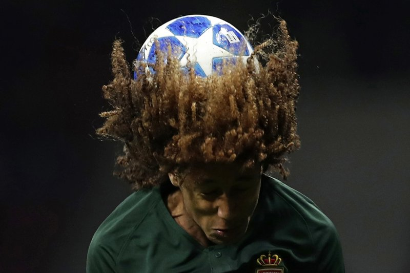 FILE - In this Wednesday, Nov. 28, 2018 file photo Monaco's Han-Noah Massengo heads the ball during a Group A Champions League soccer match between Atletico Madrid and Monaco at the Metropolitano stadium in Madrid. (AP Photo/Manu Fernandez, File)
