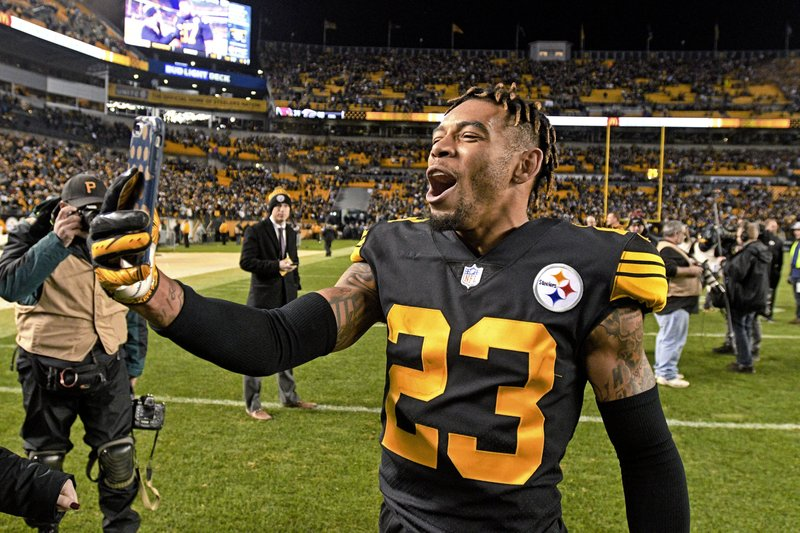 Pittsburgh Steelers cornerback Joe Haden (23) celebrates as he walks off the field following a win over the New England Patriots in an NFL football game in Pittsburgh, Sunday, Dec. (AP Photo/Don Wright)