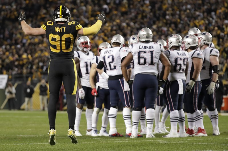 Pittsburgh Steelers outside linebacker T.J. Watt (90) calls the crowd to action as New England Patriots quarterback Tom Brady (12) huddles his team during the second half of an NFL football game in Pittsburgh, Sunday, Dec. (AP Photo/Don Wright)