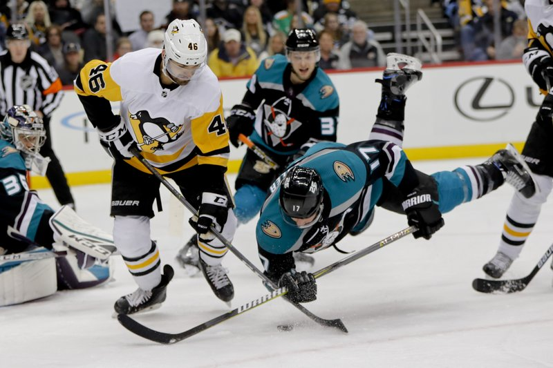 Anaheim Ducks' Ryan Kesler (17) tumbles as he and Pittsburgh Penguins' Zach Aston-Reese (46) battle for the puck during the second period of an NHL hockey game, Monday, Dec. (AP Photo/Keith Srakocic)