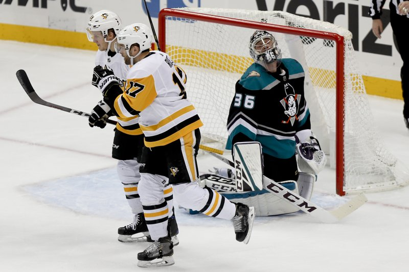 Anaheim Ducks goaltender John Gibson (36) looks up after Pittsburgh Penguins' Bryan Rust (17) scored during the first period of an NHL hockey game, Monday, Dec. (AP Photo/Keith Srakocic)
