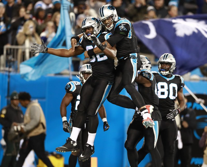 Carolina Panthers' Cam Newton, center right, celebrates with Chris Manhertz (82) after their touchdown against the New Orleans Saints in the first half of an NFL football game in Charlotte, N. (AP Photo/Jason E. Miczek)