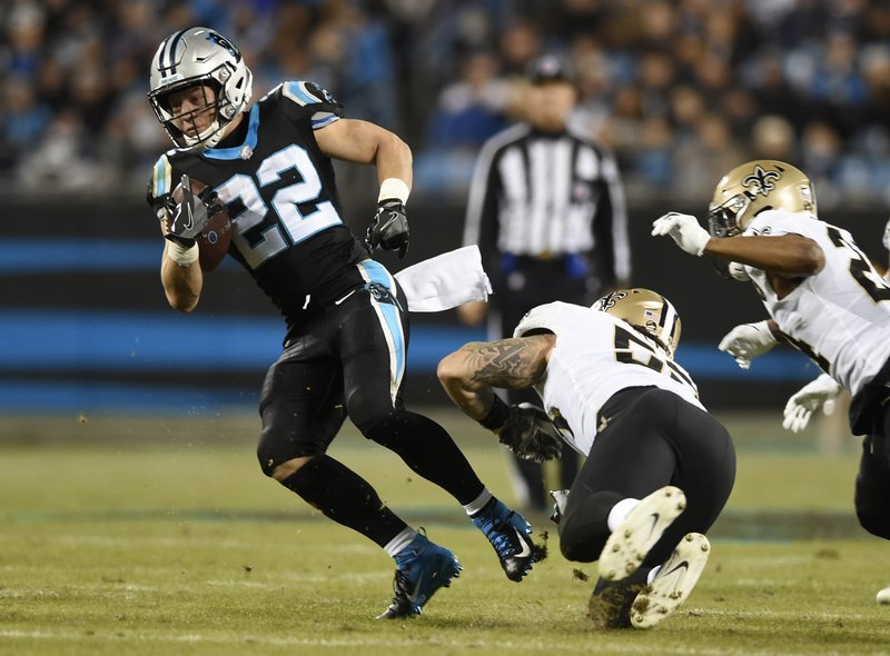 Carolina Panthers' Christian McCaffrey (22) evades a tackle by New Orleans Saints' A.J. Klein (53) in the first half of an NFL football game in Charlotte, N. (AP Photo/Mike McCarn)