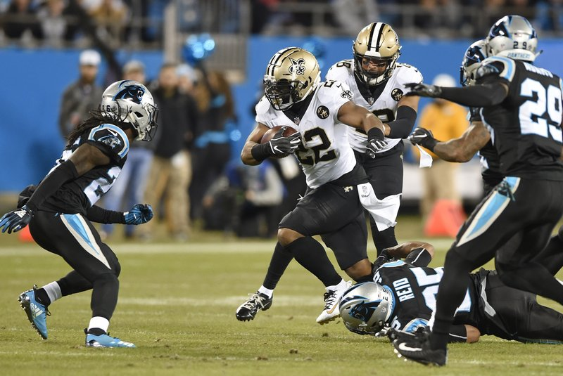 New Orleans Saints' Mark Ingram (22) runs against the Carolina Panthers in the first half of an NFL football game in Charlotte, N. (AP Photo/Mike McCarn)
