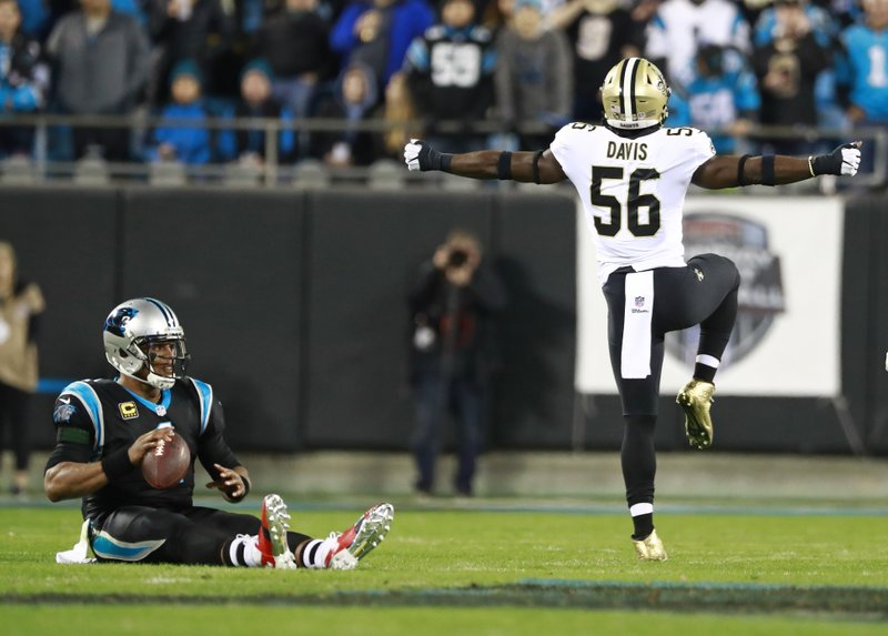 New Orleans Saints' Demario Davis (56) celebrates his sack of Carolina Panthers' Cam Newton, left, in the first half of an NFL football game in Charlotte, N. (AP Photo/Jason E. Miczek)