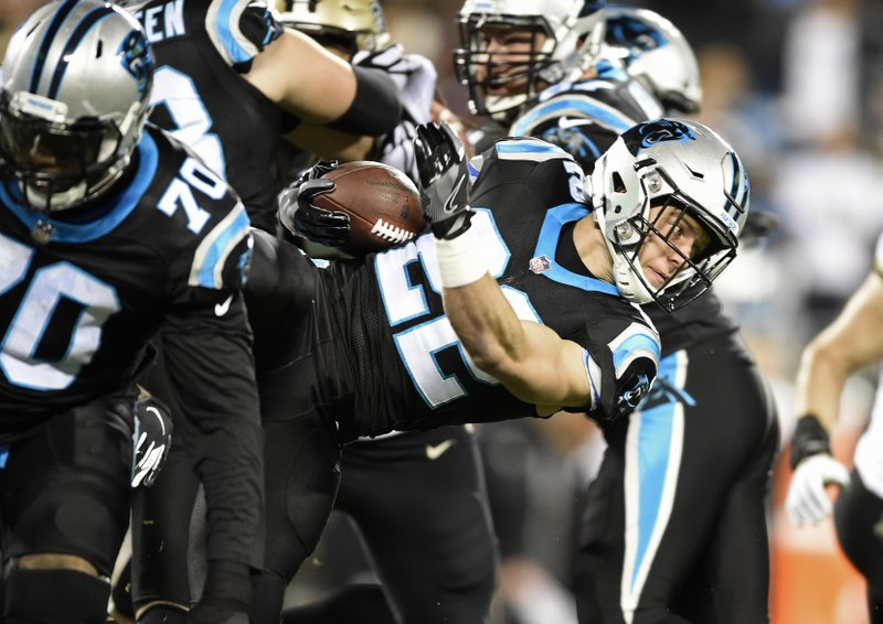 Carolina Panthers' Christian McCaffrey (22) runs against the New Orleans Saints in the first half of an NFL football game in Charlotte, N. (AP Photo/Mike McCarn)