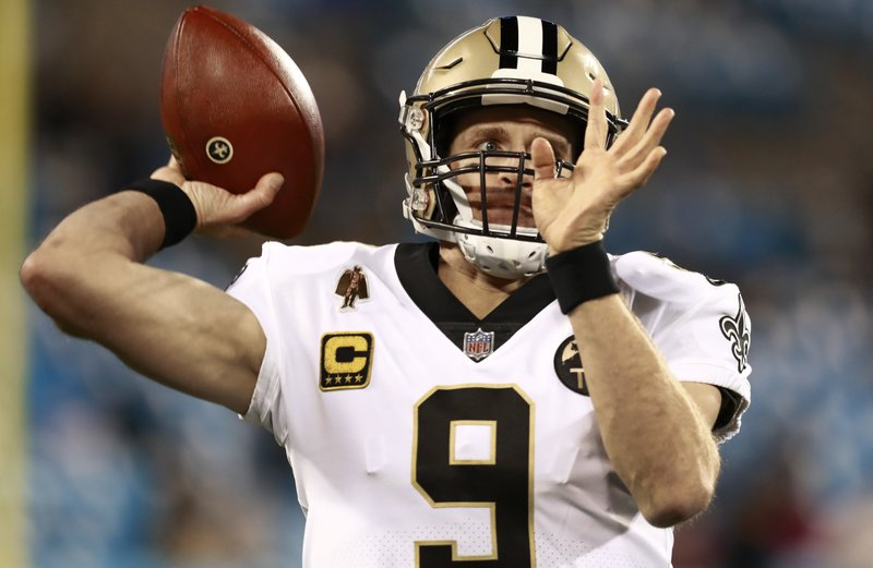 New Orleans Saints' Drew Brees (9) warms up before an NFL football game against the Carolina Panthers in Charlotte, N. (AP Photo/Jason E. Miczek)