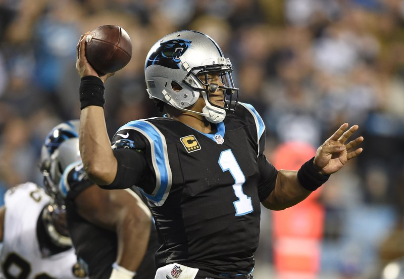Carolina Panthers' Cam Newton (1) looks to pass against the New Orleans Saints in the first half of an NFL football game in Charlotte, N. (AP Photo/Mike McCarn)