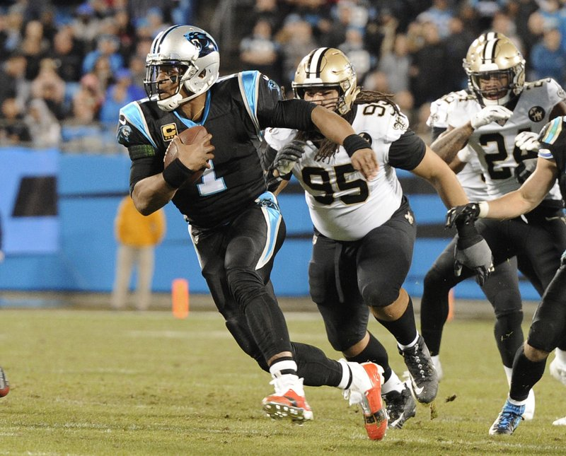 Carolina Panthers' Cam Newton (1) scrambles past New Orleans Saints' Tyeler Davison (95) in the first half of an NFL football game in Charlotte, N. (AP Photo/Mike McCarn)