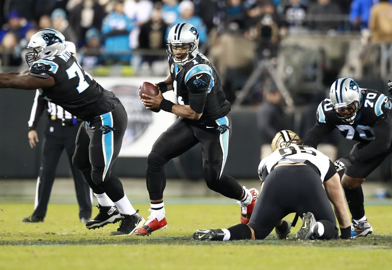 Carolina Panthers' Cam Newton (1) runs against the New Orleans Saints in the second half of an NFL football game in Charlotte, N. (AP Photo/Jason E. Miczek)