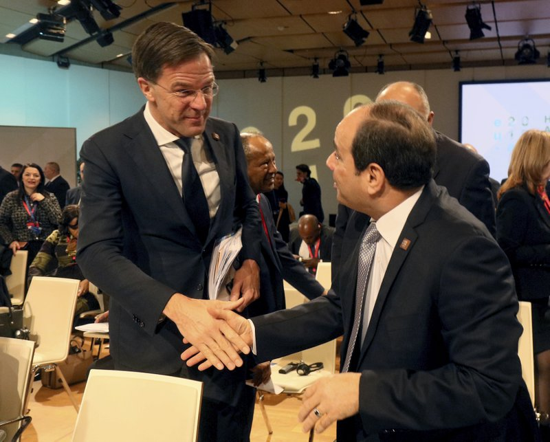 Dutch Prime Minister Mark Rutte welcomes Egyptian President Abdel-Fattah el-Sissi, from left, at the start of the EU Africa Forum in Vienna, Austria, Tuesday, Dec. (AP Photo/Ronald Zak)