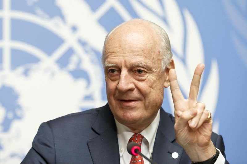 UN Special Envoy for Syria Staffan de Mistura gestures to the media after the consultations on Syria, at the European headquarters of the United Nations in Geneva, Switzerland, Tuesday, Dec. (Salvatore Di Nolfi/Keystone via AP)
