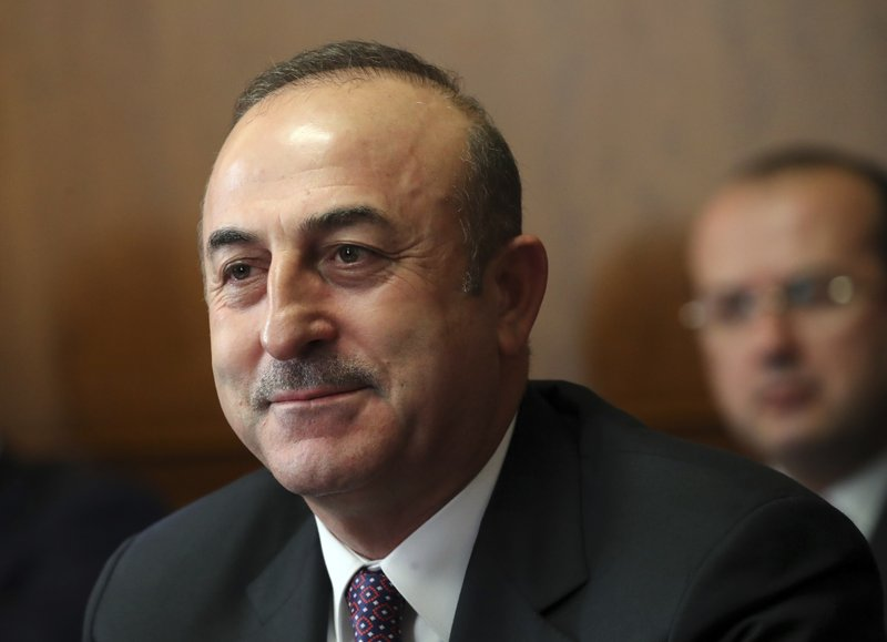 Turkish foreign minister Mevlut Cavusoglu attends a meeting on forming a constitutional committee in Syria at the European headquarters of the United Nations in Geneva, Switzerland, Tuesday, Dec. (Denis Balibouse/pool photo via AP)