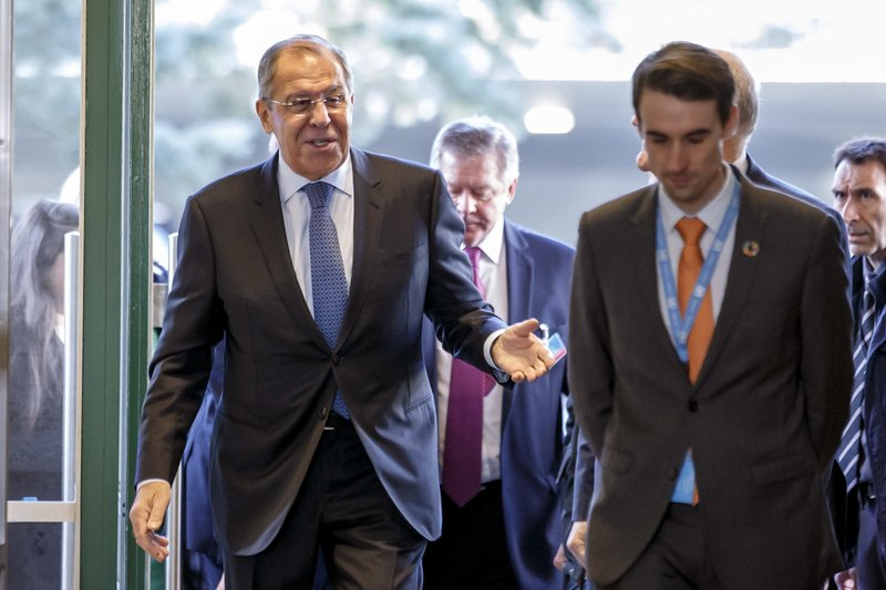 Russian Foreign Minister Sergei Lavrov, left, arrives to take part in consultations on Syria, at the European headquarters of the United Nations in Geneva, Switzerland, Tuesday, Dec. (Salvatore Di Nolfi/Keystone via AP)