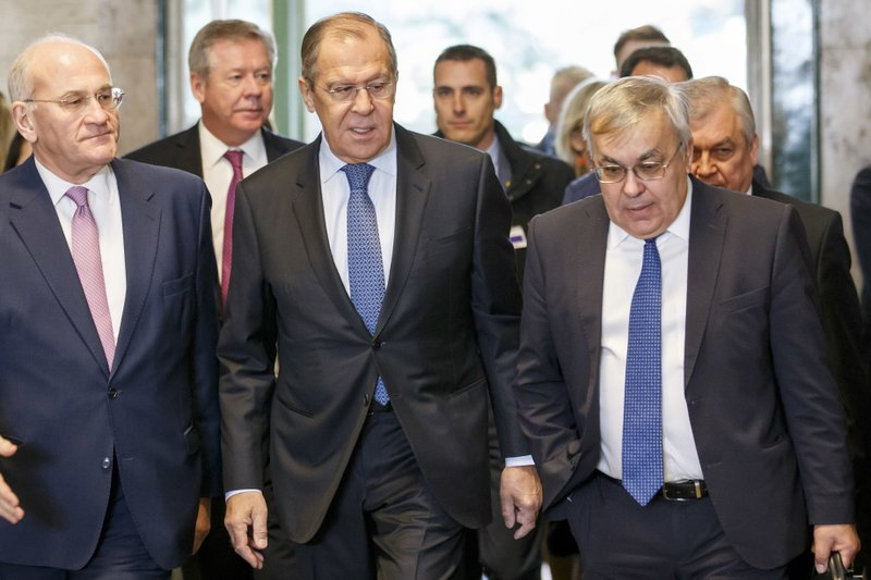 Russian Foreign Minister Sergei Lavrov arrives to take part in consultations on Syria, at the European headquarters of the United Nations in Geneva, Switzerland, Tuesday, Dec. (Salvatore Di Nolfi/Keystone via AP)