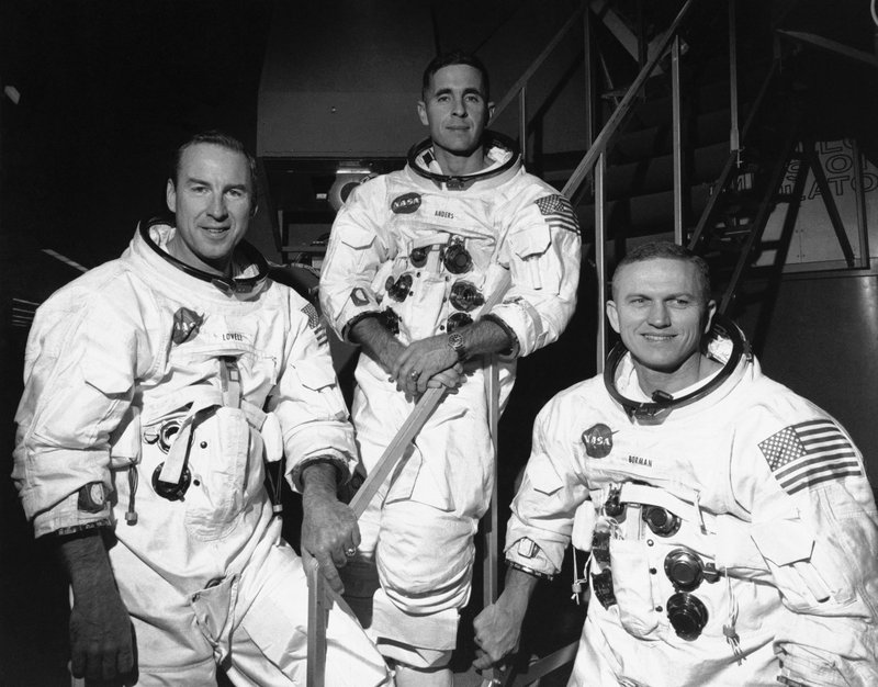 FILE - In this Dec. 18, 1968, file photo, Apollo 8 astronauts, from left, James Lovell, command module pilot; William Anders, lunar module pilot; and Frank Borman, commander, stand in front of mission simulator prior to training in exercise for their scheduled six-day lunar orbital mission at the Kennedy Space Center in Florida. (AP Photo/File)