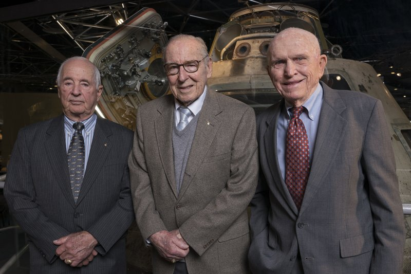 FILE - This April 5, 2018 photo provided by the Museum of Science and Industry, Chicago shows Apollo 8 astronauts, from left, William Anders, James Lovell, Frank Borman at the museum. (J.B. Spector/Museum of Science and Industry, Chicago via AP, File)