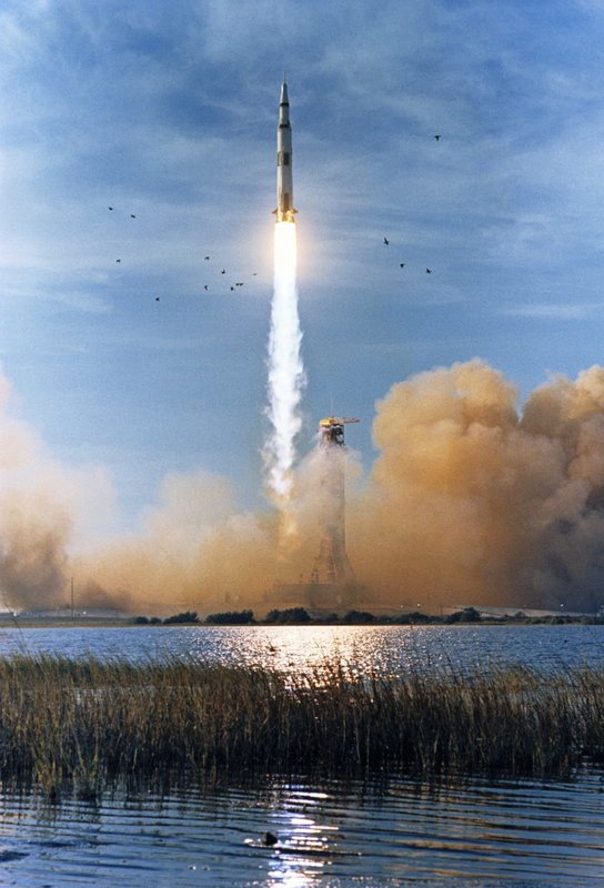 In this Dec. 21, 1968 photo made available by NASA, the Saturn V rocket carrying the Apollo 8 crew launches from the Kennedy Space Center in Florida with 7. (NASA via AP, File)