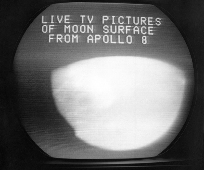 FILE - This Dec. 24, 1968, file photo shows a television screen with a view of the moon transmitted by the Apollo 8 astronauts as it orbited. (AP Photo/Anthony Camerano, File)