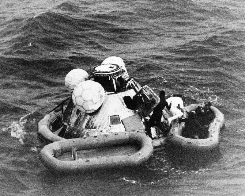 FILE - In this Dec. 27, 1968 file photo, divers help recover the Apollo 8 crew from their capsule after splashdown in the Pacific Ocean. (AP Photo/File)