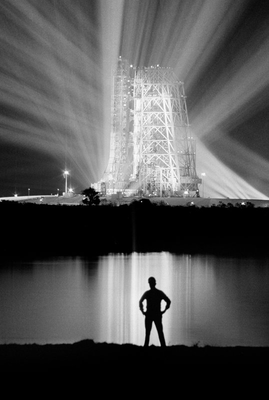 FILE - In this Dec. 19, 1968, file photo, spotlights illuminate the 363-foot-tall Saturn V booster rocket on the launch pad at the Kennedy Space Center in Florida, carrying the Apollo 8 spacecraft and its crew of three astronauts. (AP Photo/File)