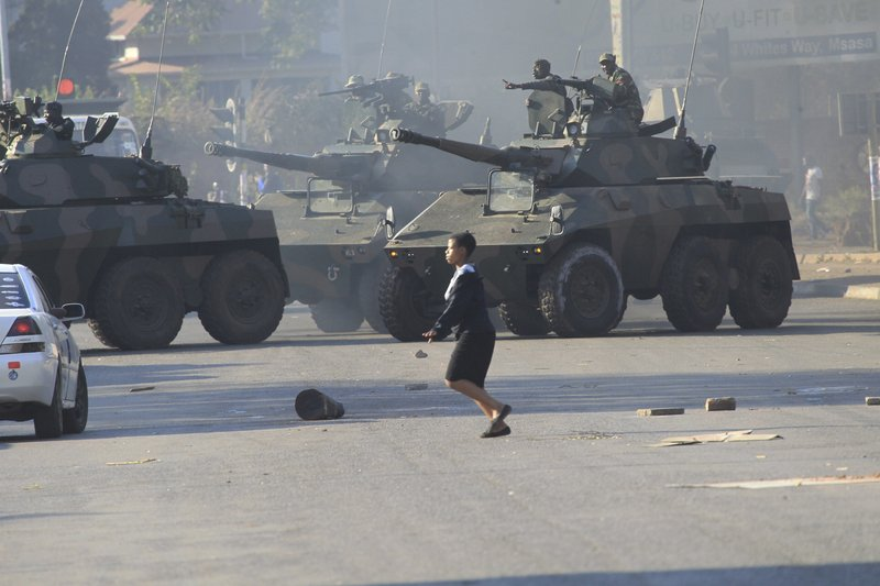 FILE - In this Aug, 1, 2018 file photo, military tanks are seen in Harare, Zimbabwe, following demonstrations by opposition party supporters. (AP Photo/Tsvangirayi Mukwazhi)