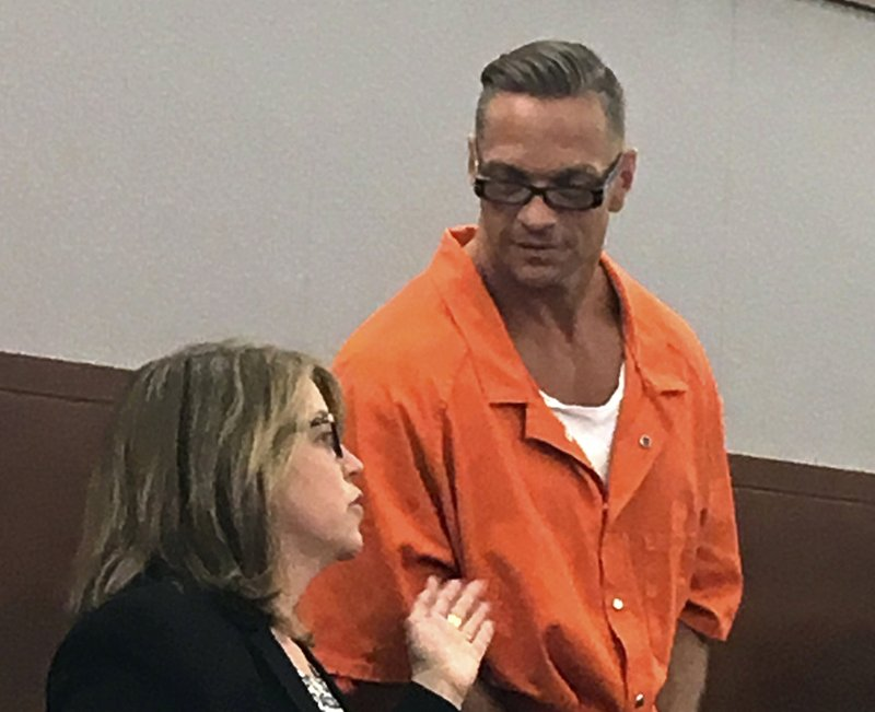 FILE - In this Aug. 17, 2017, file photo, Nevada death row inmate Scott Dozier, right, confers with Lori Teicher, a federal public defender involved in his case, during an appearance in Clark County District Court in Las Vegas. (AP Photo/Ken Ritter, File)