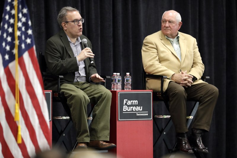 Acting EPA administrator Andrew Wheeler, left, and Agriculture Secretary Sonny Perdue answer questions Tuesday, Dec. (AP Photo/Mark Humphrey)