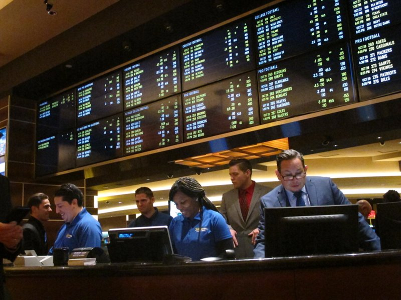 This Oct. 25, 2018 photo shows employees at the new sports book at the Tropicana casino in Atlantic City N. (AP Photo/Wayne Parry)