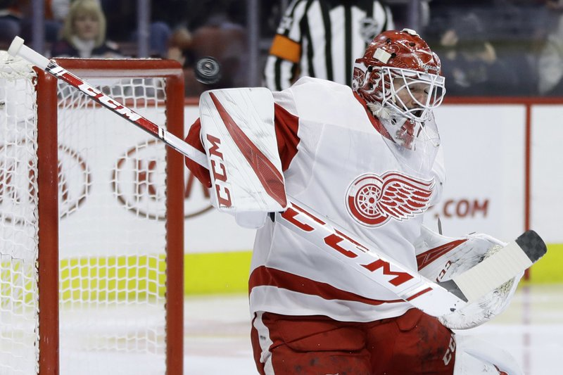 Detroit Red Wings' Jonathan Bernier blocks a shot during the second period of an NHL hockey game against the Philadelphia Flyers, Tuesday, Dec. (AP Photo/Matt Slocum)