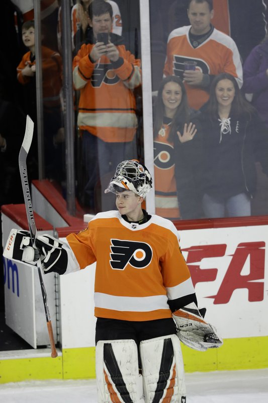 Philadelphia Flyers' Carter Hart acknowledges the crowd after an NHL hockey game against the Detroit Red Wings, Tuesday, Dec. (AP Photo/Matt Slocum)