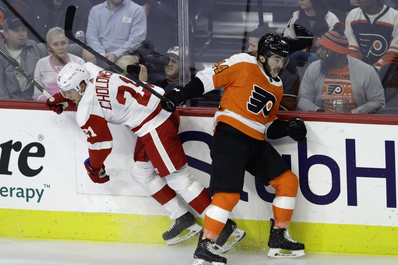 Detroit Red Wings' Dennis Cholowski, left, and Philadelphia Flyers' Philip Varone collide during the third period of an NHL hockey game, Tuesday, Dec. (AP Photo/Matt Slocum)