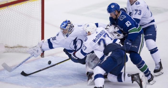 Tampa Bay Lightning goaltender Andrei Vasilevskiy (88) tries to stop Vancouver  Canucks defenceman Christopher Tanev s goal as Tampa Bay Lightning  defenceman ... 646918af1