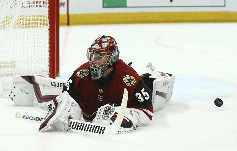 Arizona Coyotes goaltender Darcy Kuemper gives up a goal to New York Islanders' Joshua Ho-Sang during the first period of an NHL hockey game Tuesday, Dec. (AP Photo/Ross D. Franklin)