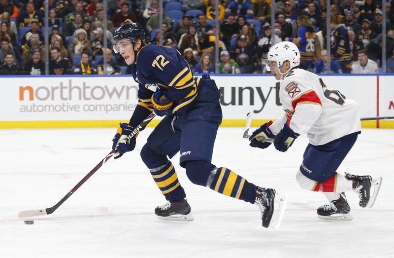 Buffalo Sabres forward Tage Thompson (72) is chased by Florida Panthers forward Denis Malgin (62) during the second period of an NHL hockey game, Tuesday, Dec. (AP Photo/Jeffrey T. Barnes)