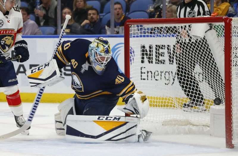 Buffalo Sabres goalie Carter Hutton (40) watches the puck go into the net during the second period of an NHL hockey game against the Florida Panthers, Tuesday, Dec. (AP Photo/Jeffrey T. Barnes)