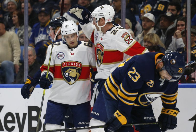Florida Panthers Denis Malgin (62) and Troy Brouwer (22) celebrates a goal during the second period of an NHL hockey game against the Buffalo Sabres, Tuesday, Dec. (AP Photo/Jeffrey T. Barnes)