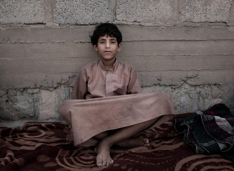 Morsal, a 14-year-old former child soldier, poses for a photograph at a camp for displaced persons where he took shelter, in Marib, Yemen, in this July 27, 2018, photo. (AP Photo/Nariman El-Mofty)