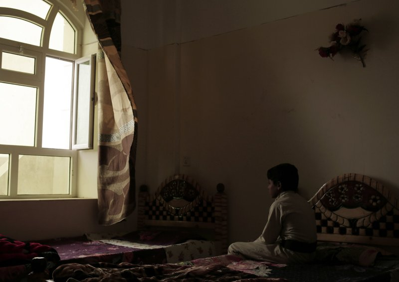 A boy sits on his bed in a rehabilitation center for former child soldiers in Marib, Yemen, in this July 28, 2018 photo. (AP Photo/Nariman El-Mofty)