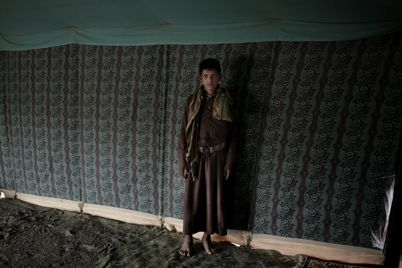 Nawaf, a 15-year-old former child soldier, poses for a photograph at a camp for displaced persons where he took shelter with his family, in Marib, Yemen, in this July 27, 2018, photo. (AP Photo/Nariman El-Mofty)