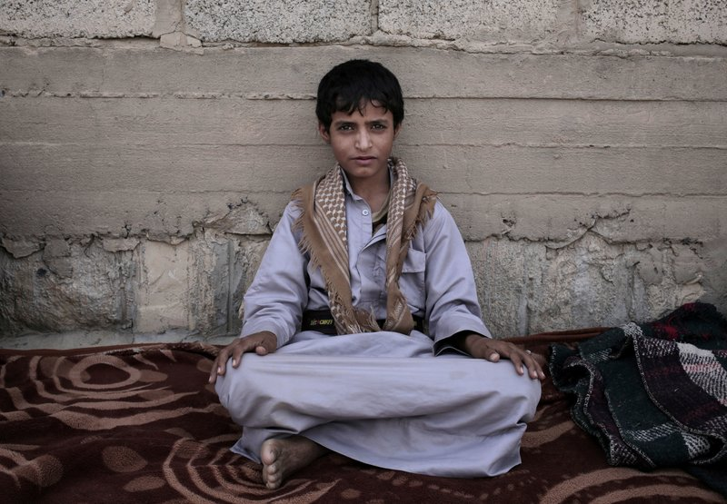Abdel-Hamid, a 14-year-old former child soldier, poses for a photograph at a camp for displaced persons where he took shelter, in Marib, Yemen, in this July 27, 2018, photo. (AP Photo/Nariman El-Mofty)