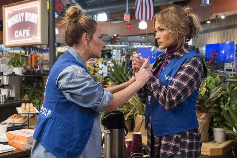 In this image released by STXfilms, Leah Remini, left, and Jennifer Lopez appear in a scene from