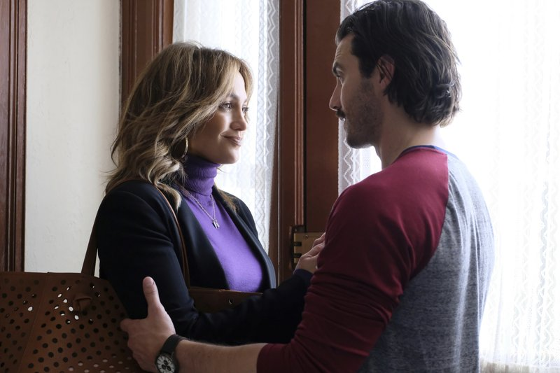 In this image released by STXfilms, Jennifer Lopez, left, and Milo Ventimiglia appear in a scene from